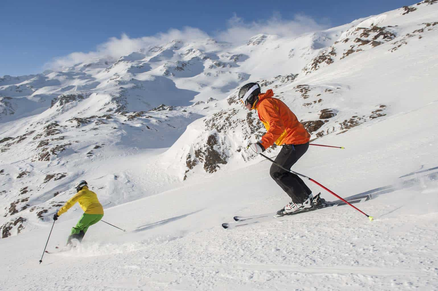 couples skiing down the mountains