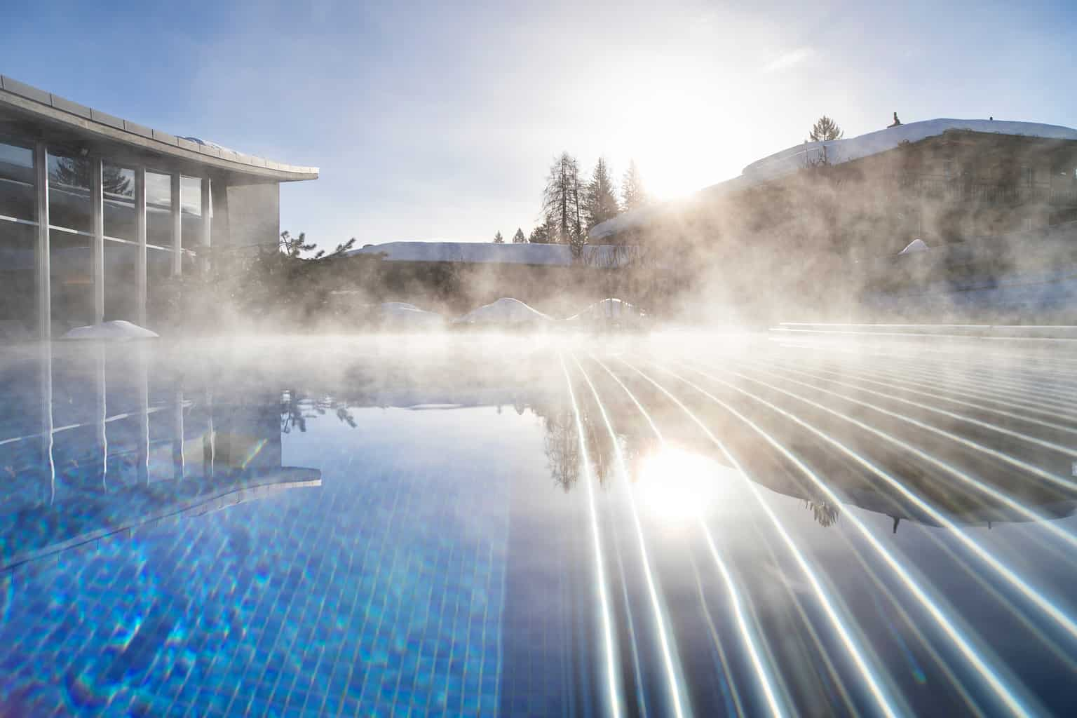 Outdoor Pool at the Adula with steam rising from the water