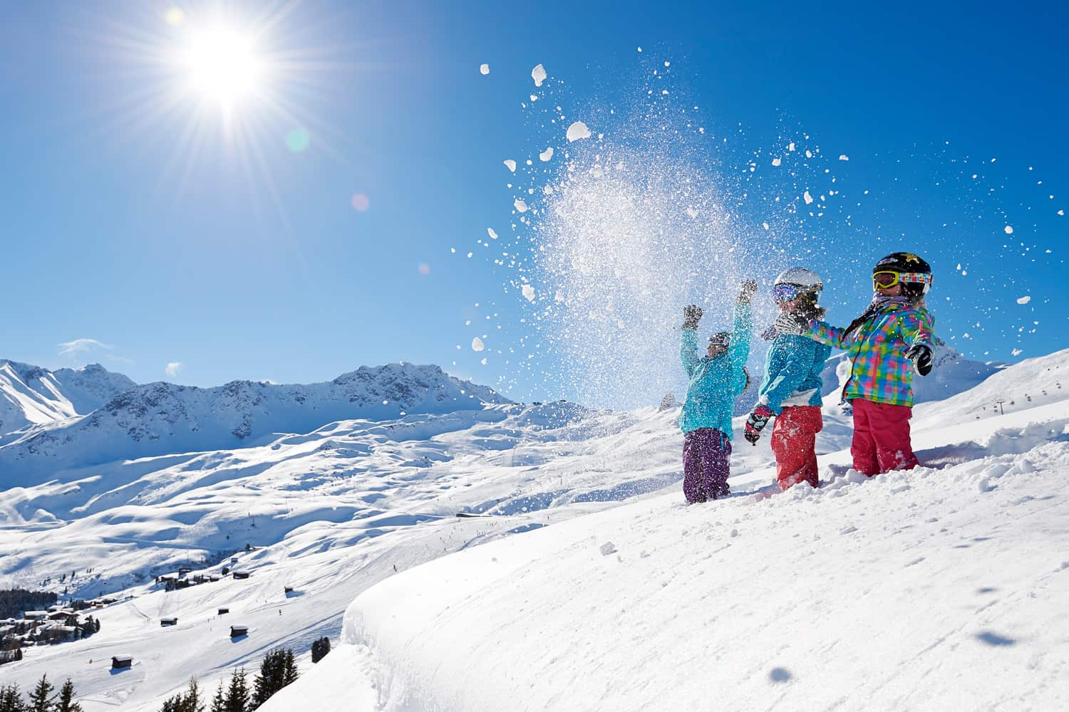 Children throwing snow in the mountains