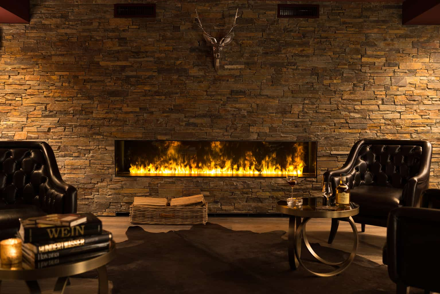 Roaring fireplace and cozy arm chair at peaks place