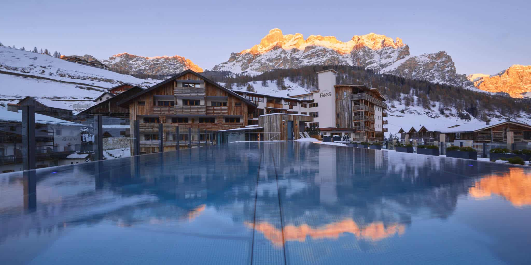 Fanes Dolomiti Pool with the San Cassiano mountains in the background