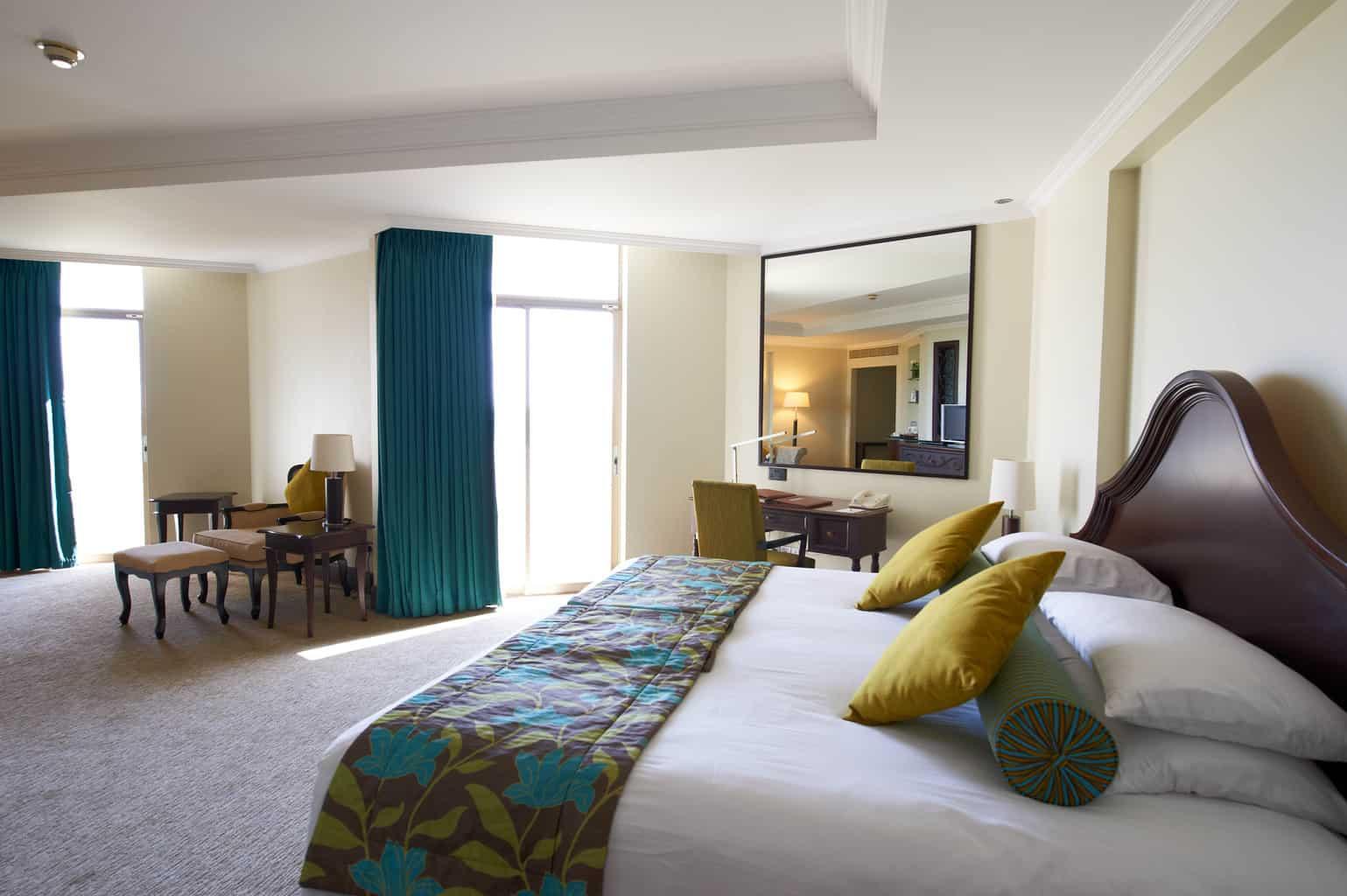 Garden View Room Accommodation at Ja Beach Hotel mirror