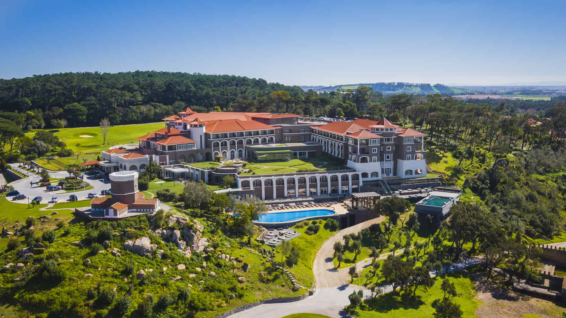 Aerial View over Penha Longa Resort with green hills and terracotta roofs